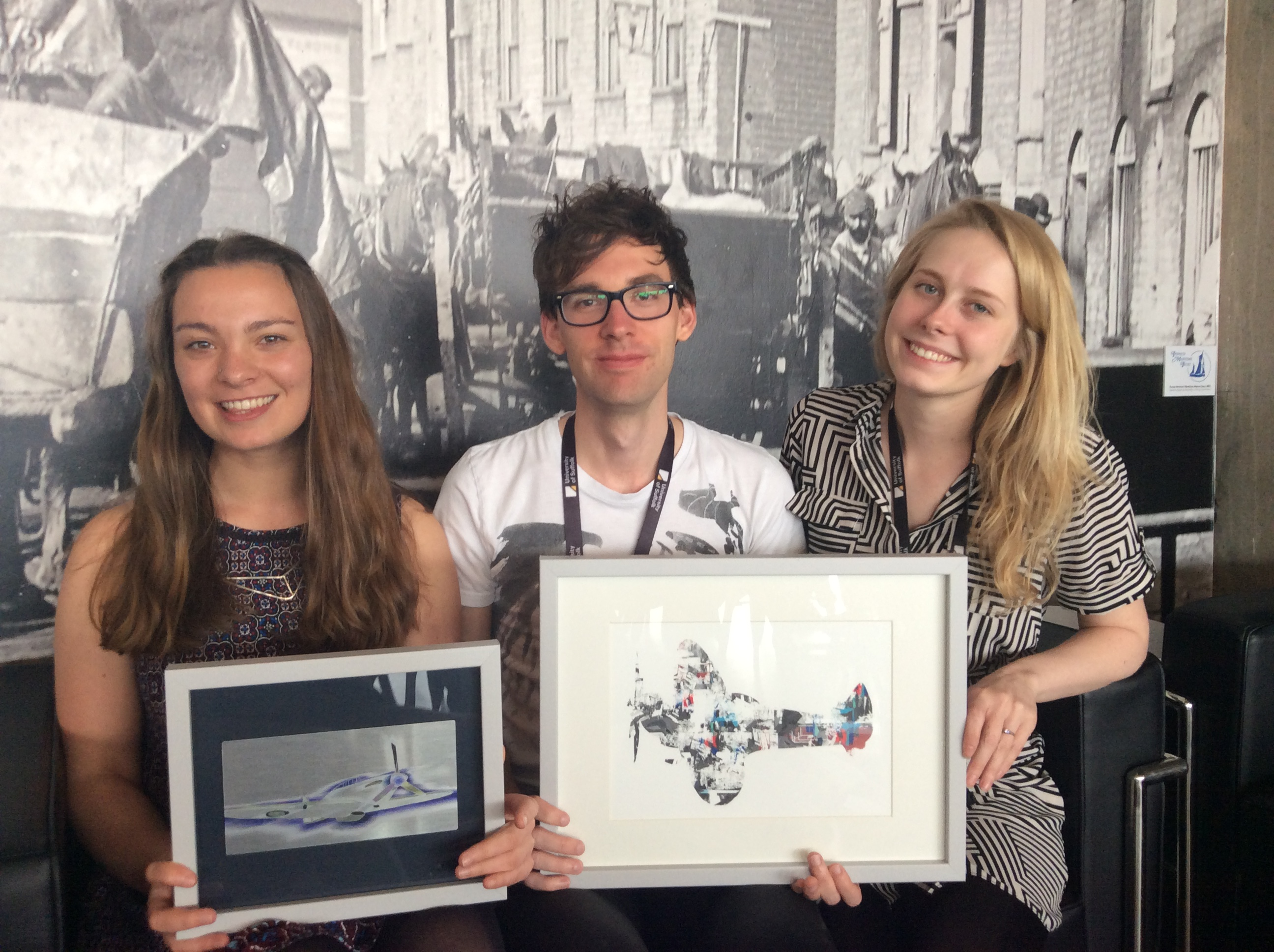 Karis Lambert, Oliver Squirrell and Laurel Warren presenting artwork to Chronicle Digital Storytelling