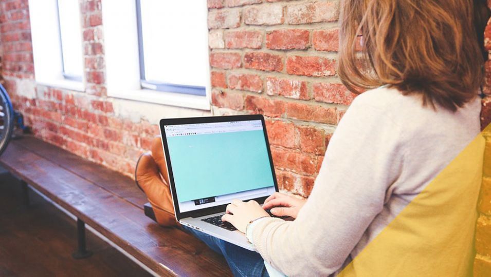 Student choosing accommodation on laptop