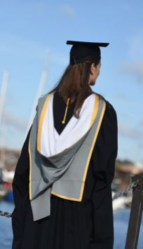 Graduating student on the waterfront