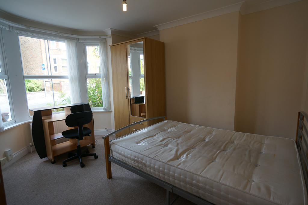Bedroom with bay window, bed, wardrobe , study desk and chair