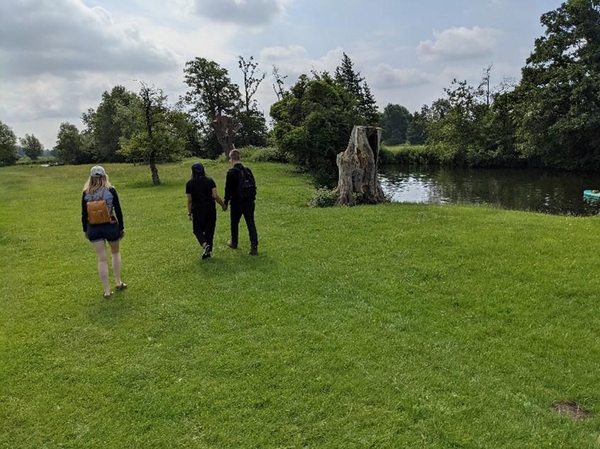 People walking along side river at Dedham