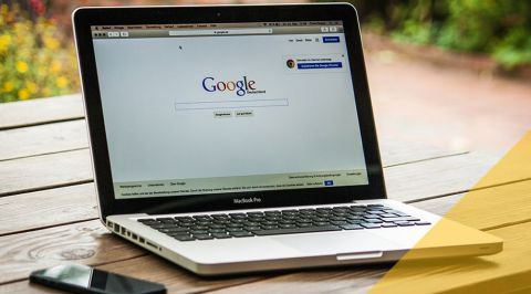 Laptop open with Google search engine