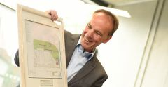 Richard Lister presented with drawings of the Waterfront Building